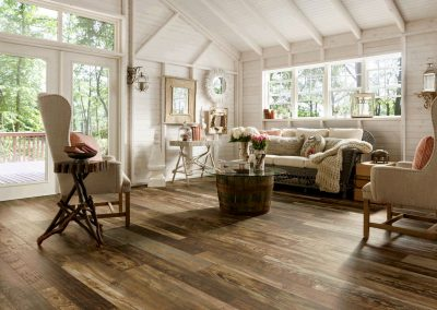 interior-country-style-living-room-with-cream-canvas-sofa-and-reclaimed-wood-look-laminate-flooring-interior-laminate-flooring-vs-hardwood-flooring