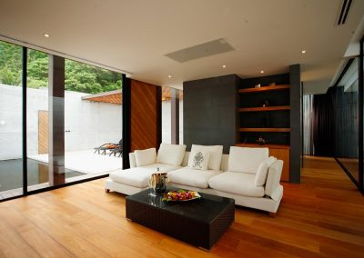 Fascinating-Living-Room-Ideas-With-Wood-Laminate-Flooring-And-White-Leather-Sofa-Cushions-Using-Square-Rattan-Dining-Table